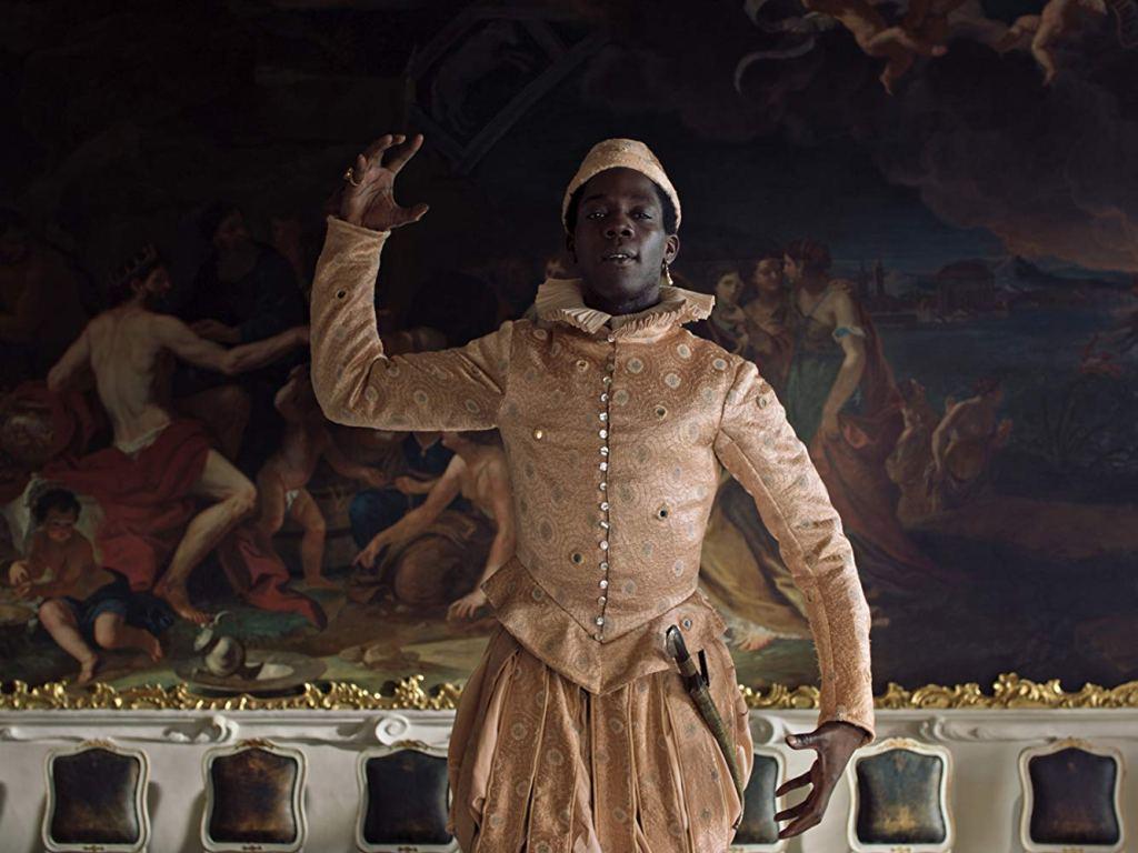 Angelo (Makita Samba) in a costume, performing.