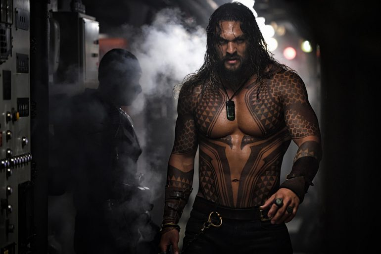 Arthur (Jason Momoa) bare-chested during a fight.