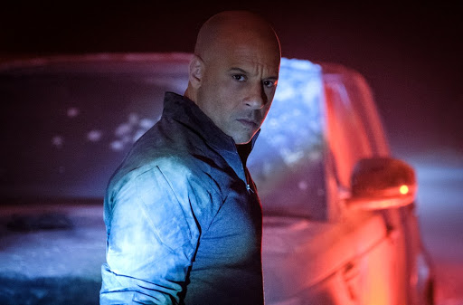 Ray/Bloodshot (Vin Diesel) standing in front of a car covered in flour.
