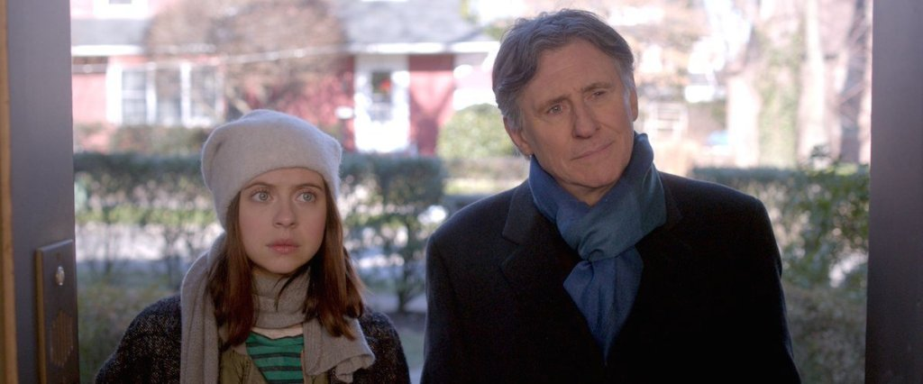 Carrie (Bel Powley) and her father (Gabriel Byrne) standing in front of a door.