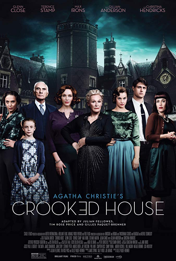 The film poster showing the main characters in front of a dark manor.