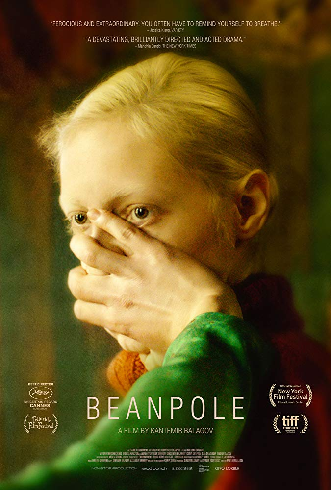 The film poster showing Iya (Viktoria Miroshnichenko) with a hand covering her face.