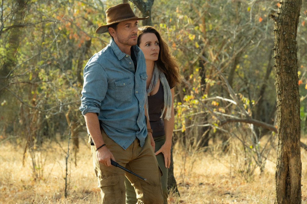 Derek (Rob Lowe) and Kate (Kristin Davis) walking in the savannah.