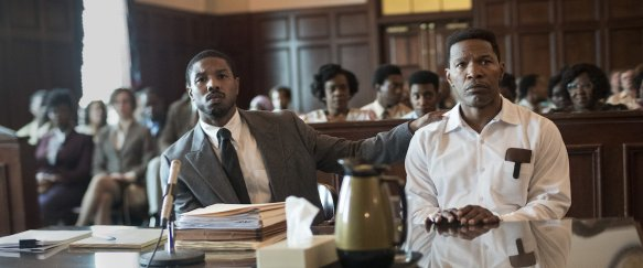 Bryan Stevenson (Michael B. Jordan) and Johnny D. (Jamie Foxx) waiting for judgement in the courtroom.