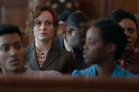 Eva Ansley (Brie Larson) in the public section of the courtroom.