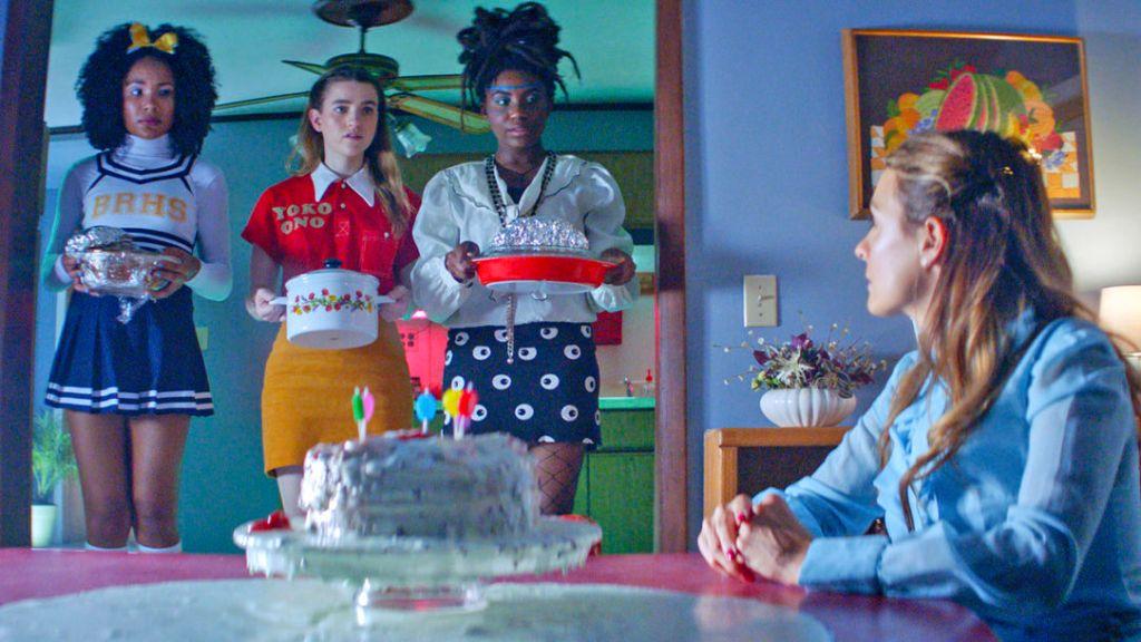 Laurel (Kayla Carter), Joanna (Grace Smith) and Charlotte (Ireon Roach) bringing Lisa Harper (Marika Engelhardt) casseroles.