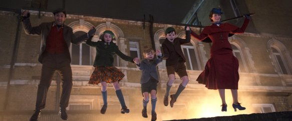 Jack (Lin-Manuel Miranda) and Mary Poppins (Emily Blunt) jumping with the three Banks children (Pixie Davies, Nathanael Saleh, Joel Dawson).