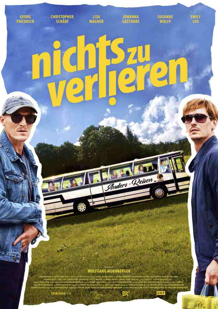 The film poster showing a bus on a meadow and Richy (Georg Friedrich) and Tom (Christopher Schärf) standing in front of it with nonplussed expressions.