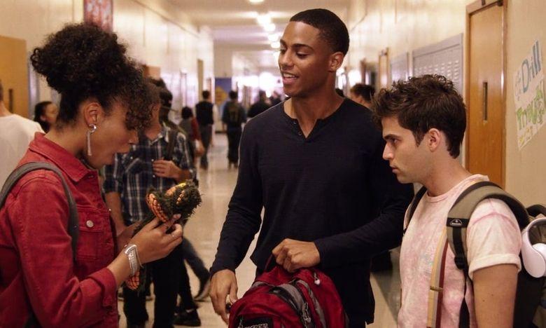 Cameron (Keith powers) gives  Dani (Nesta Cooper) a stuffed animal.