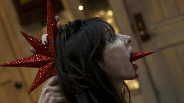 A woman impaled through the back of her head by a Christmas tree star.
