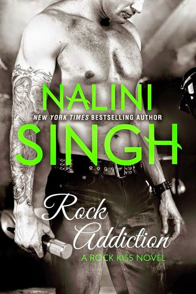 The book cover showing a shirtless guy with a tattoed arm and a microphone in his hand.