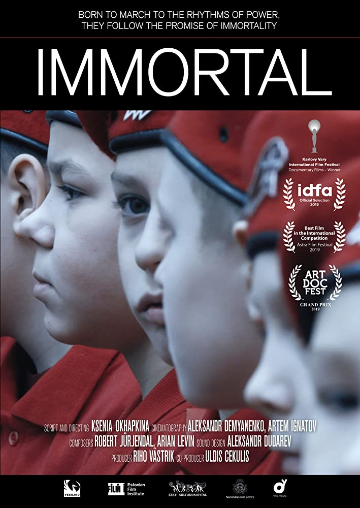 The film poster showing a group of boys dressed in red uniforms.