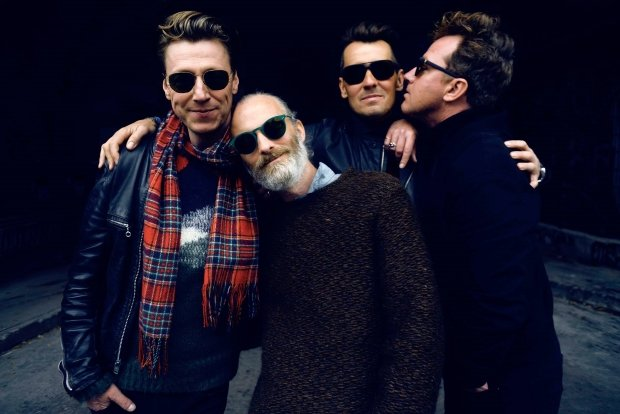 The band Travis, consisting of four white guys, in sunglasses.