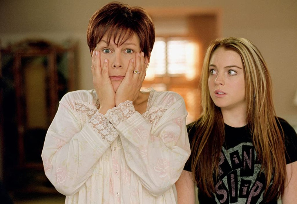 Anna in Tess' body (Jamie Lee Curtis) clutching her face as Tess in Anna's body (Lindsay Lohan) looks on.
