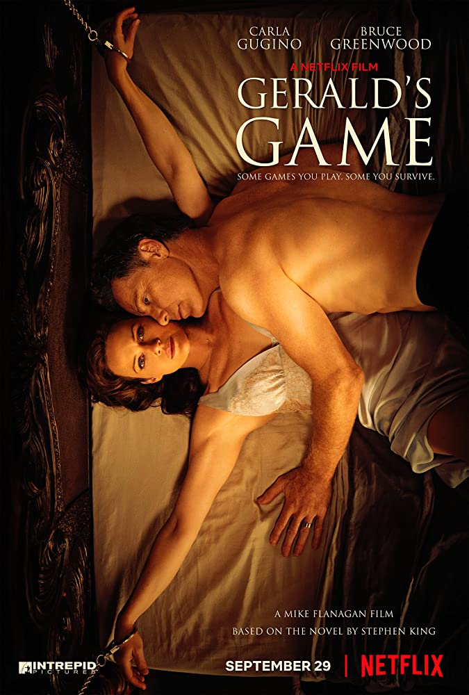 The film poster showing Jessie (Carla Gugino) with her hands chained to the bed, her husband Gerald (Bruce Greenwood) lying on top of her.