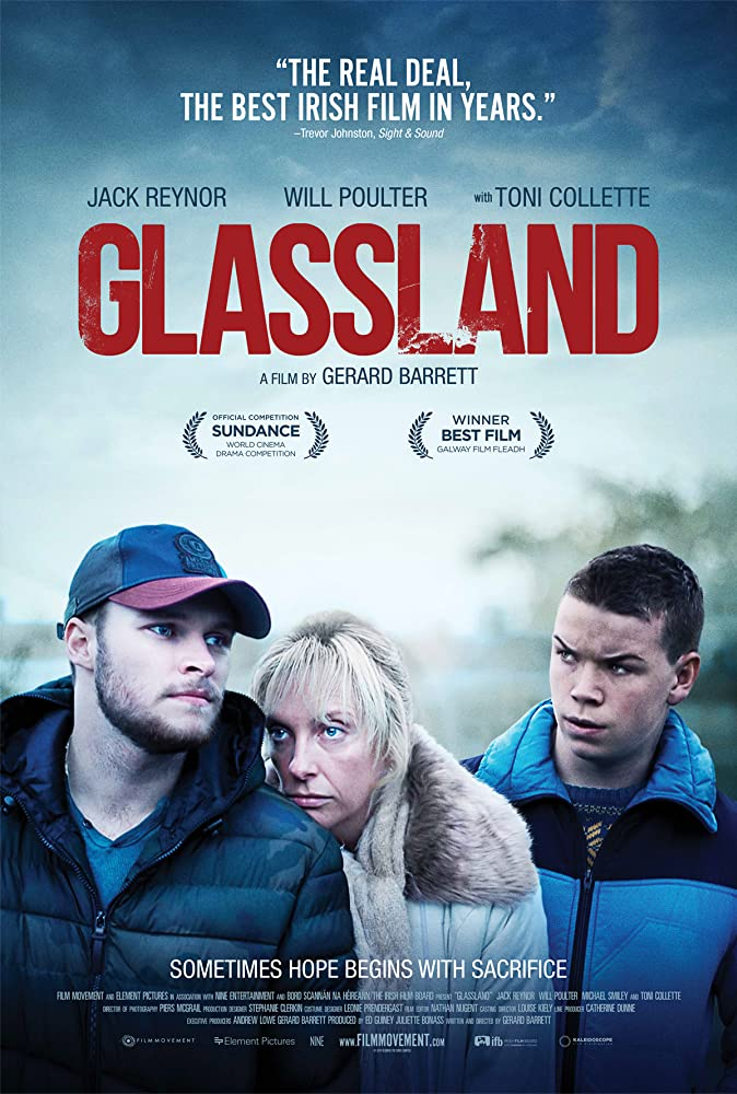The film poster showing Jean (Toni Collette) leaning against John (Jack Reynor), Shane (Will Poulter) standing behind them.