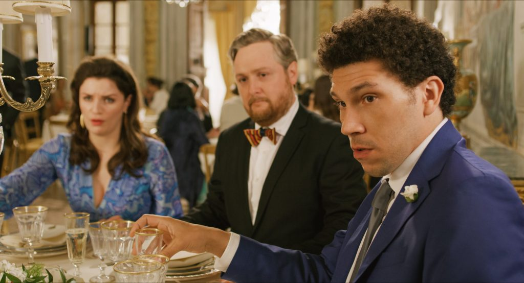 Bryan (Joel Fry), Sidney (Tim Key) and Rebecca (Aisling Bea) at the dinner table.