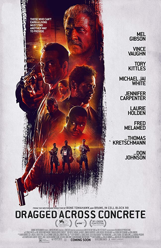 The film poster showing the main characters in red paint that looks like something was dragged over the white poster background.