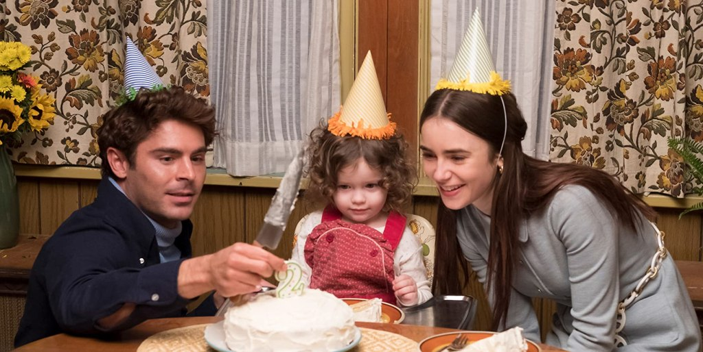 Ted (Zac Efron) and Liz (Lily Collins) celebrating their daughter's birthday.