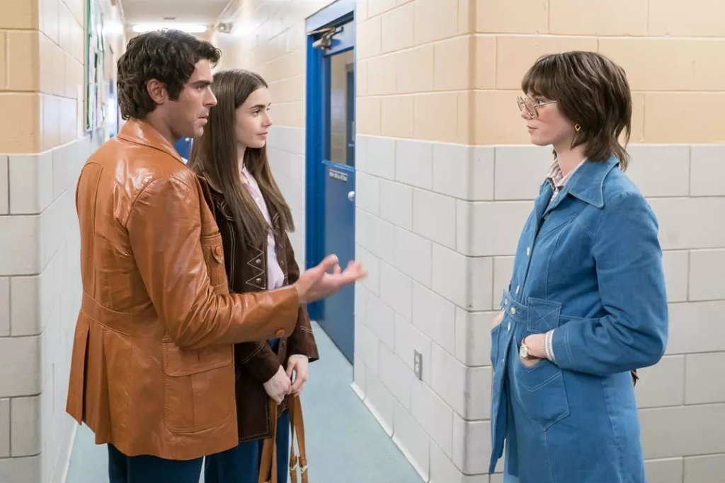 Ted (Zac Efron) and Liz (Lily Collins) meet Carole Ann Boone (Kaya Scodelario).