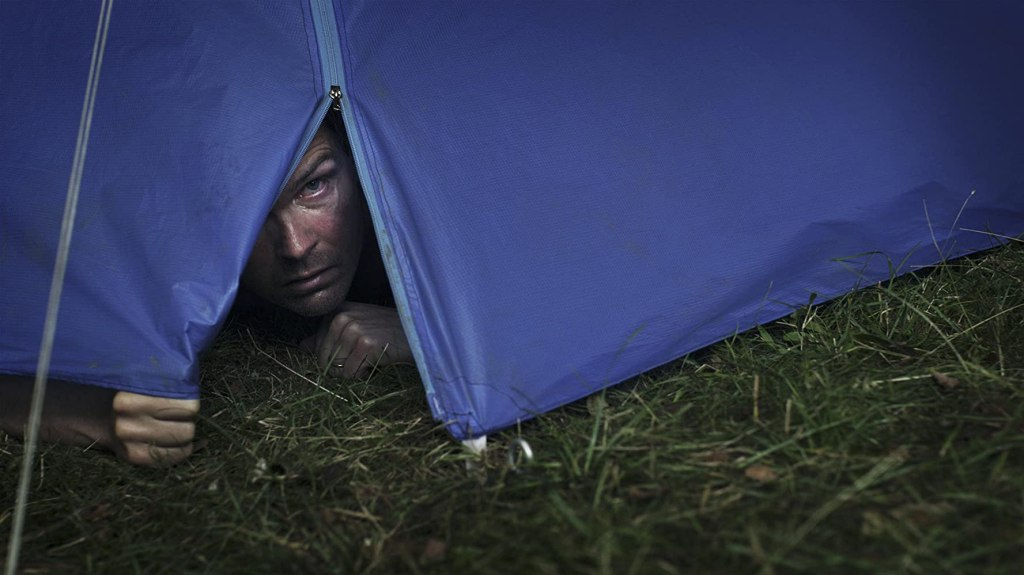 Tobias (Leif Edlund) peeking out of his tent.