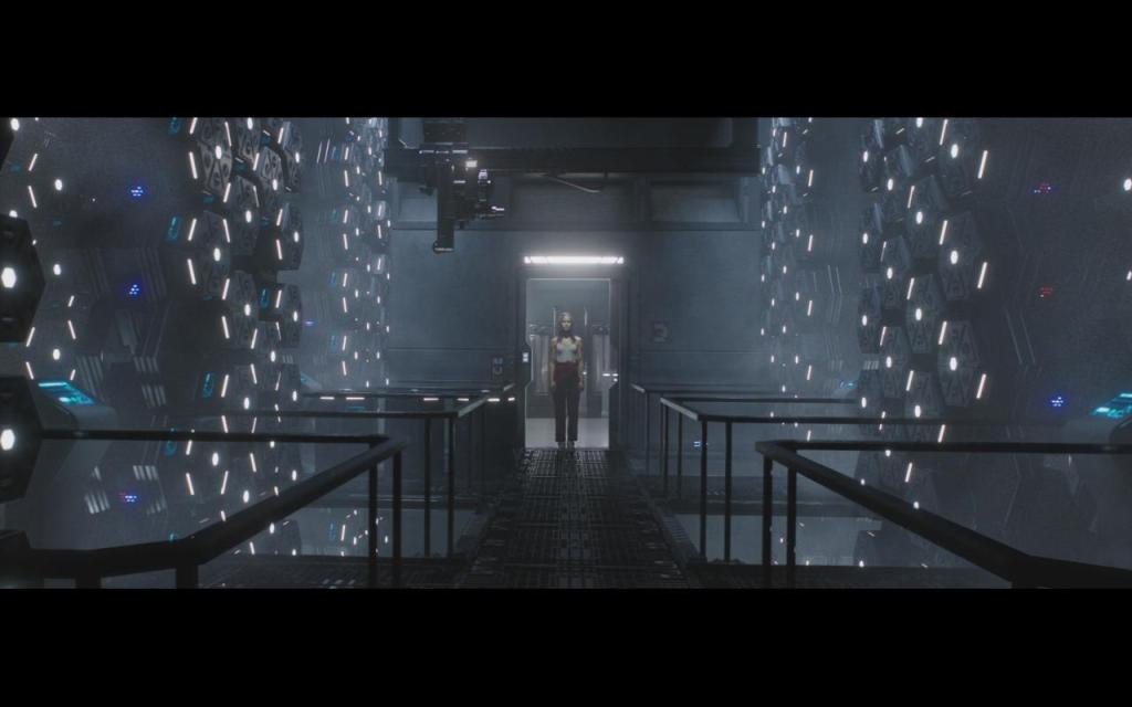 The Daughter (Clara Rugaard) in a futuristic storage facility.