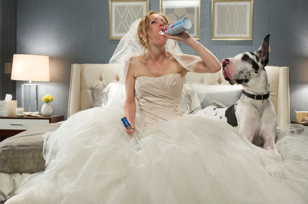 Kate (Leslie Mann) wearing her wedding dress, eating whipped cream straight from a can.