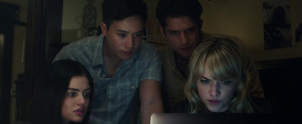 Olivia (Lucy Hale), Brad (Hayden Szeto), Lucas (Tyler Posey) and Markie (Violett Beane) looking at a computer screen.