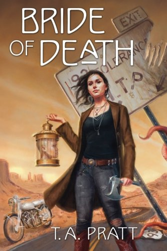 The book cover showing a dark-haired woman with a hatchet and a head in a bird cage standing in front of highway and a white motorcycle.