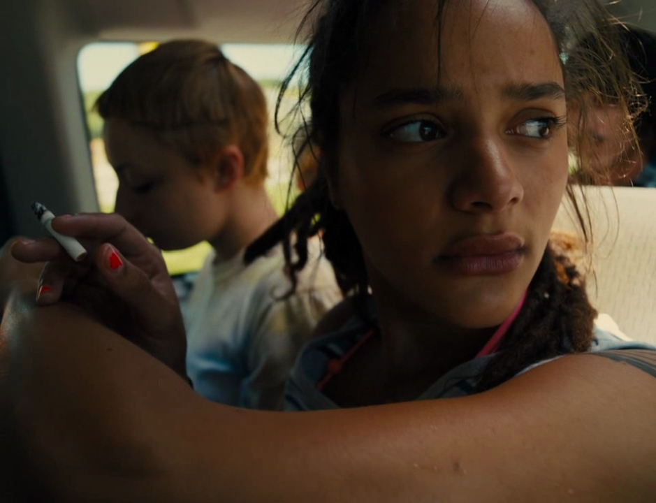 Star (Sasha Lane) looking out the car window.