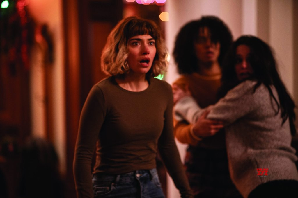 Riley (Imogen Poots) looking shocked.