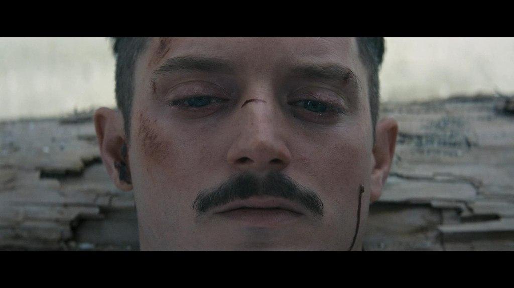 Norval (Elijah Wood) looking beat up.