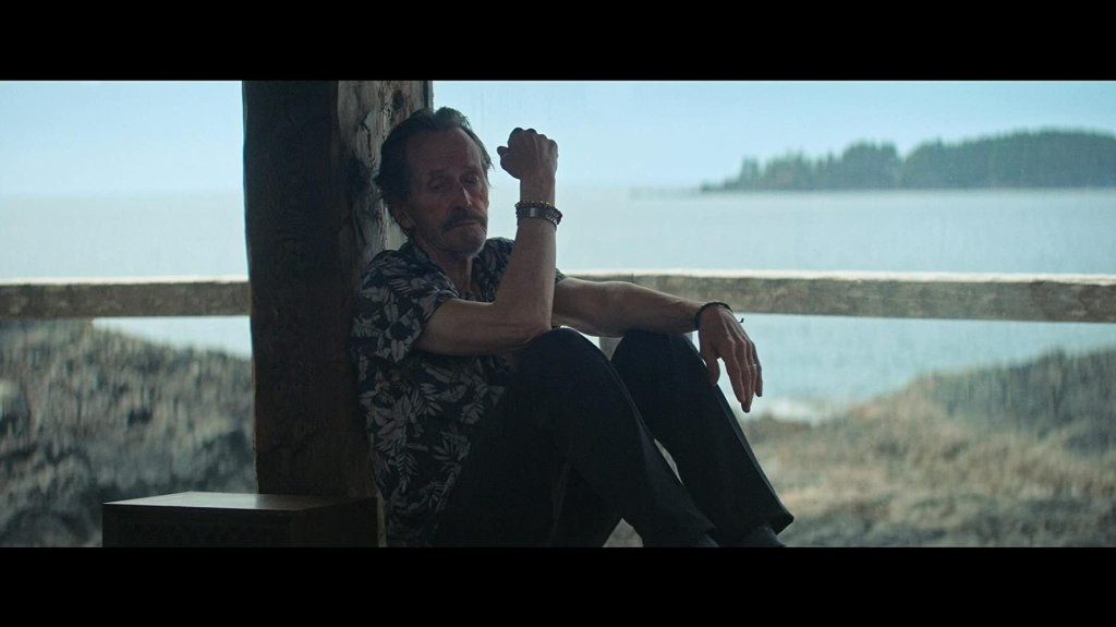 Gordon (Stephen McHattie) sitting on the porch, looking tired.