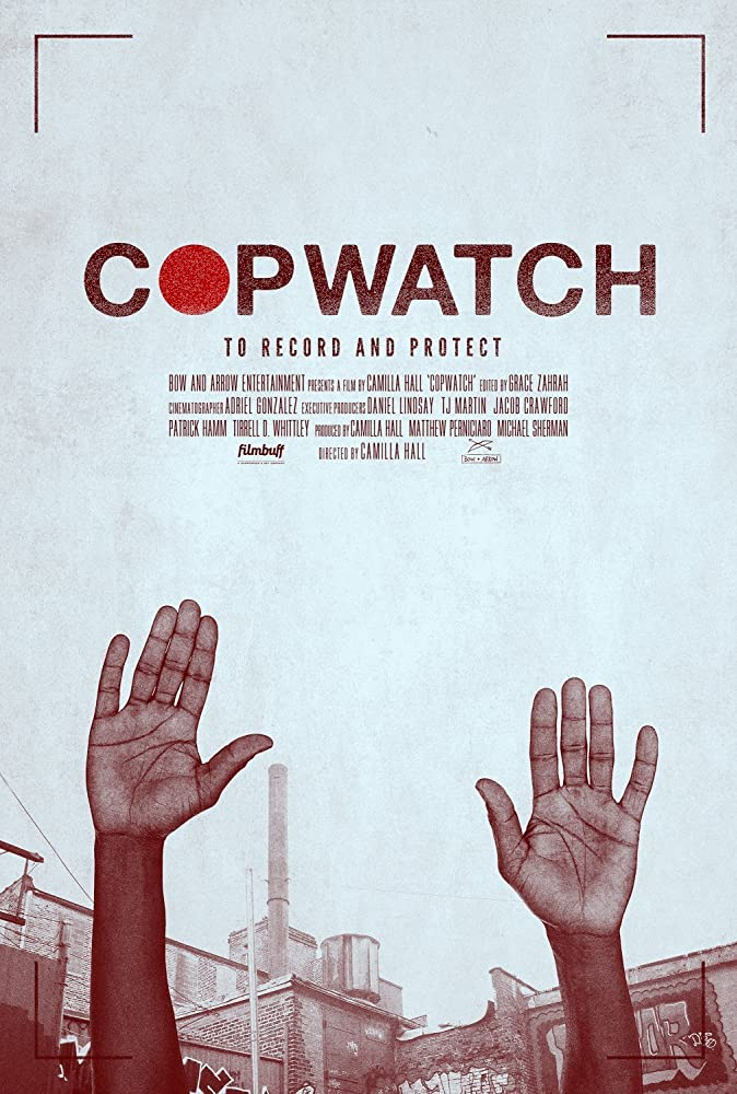 The film poster showing the hands of a Black person raised high.