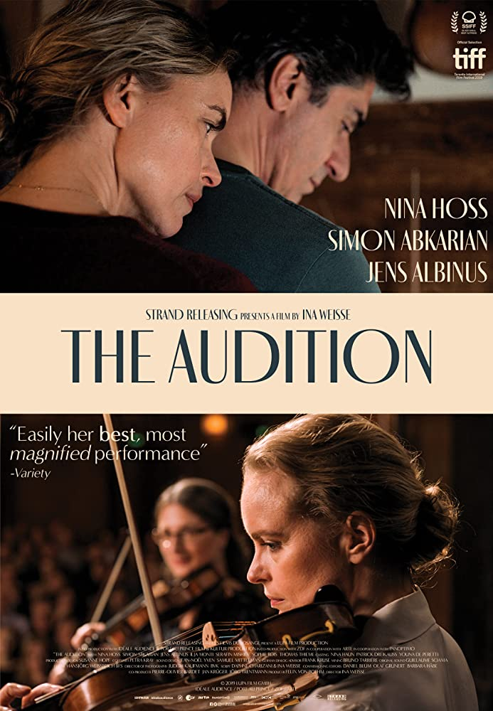 The film poster showing Anna (Nina Hoss) hugging her husband Philippe (Simon Abkarian) from behind at the top and below it, Anna playing the violin.