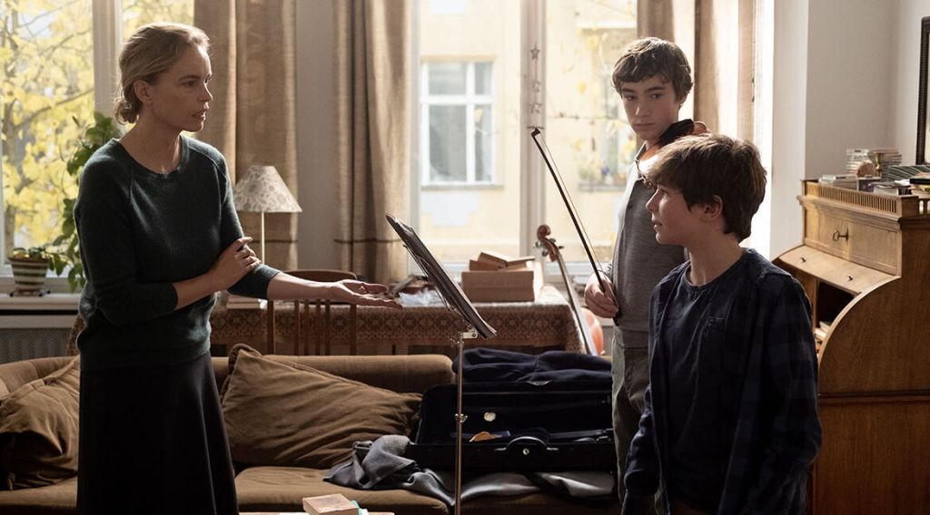 Anna (Nina Hoss) working with her student Alexander (Ilja Monti) and her son Jonas (Serafin Mishiev).