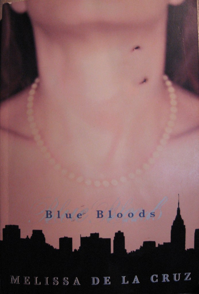 The book cover showing a neck with a pearl necklace and bloody vampire bite marks.