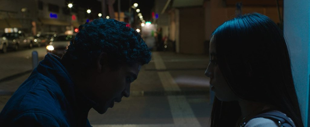 Miguel (Benny Emmanuel) talking to Carmela (Renée Sabina).