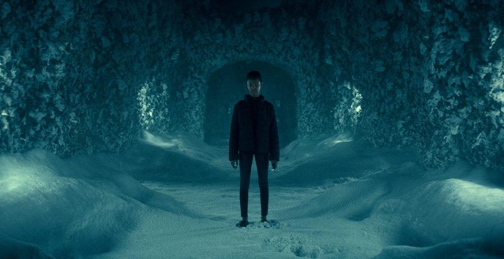 Abra (Kyliegh Curran) standing in a snowy maze.