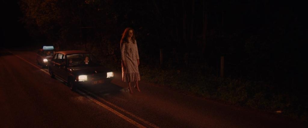 Two cars following a levitating teenage girl.