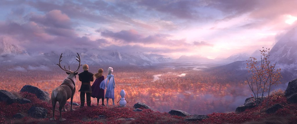 Sven, Kristoff, Anna, Elsa and Olaf overlooking a valley in fall.
