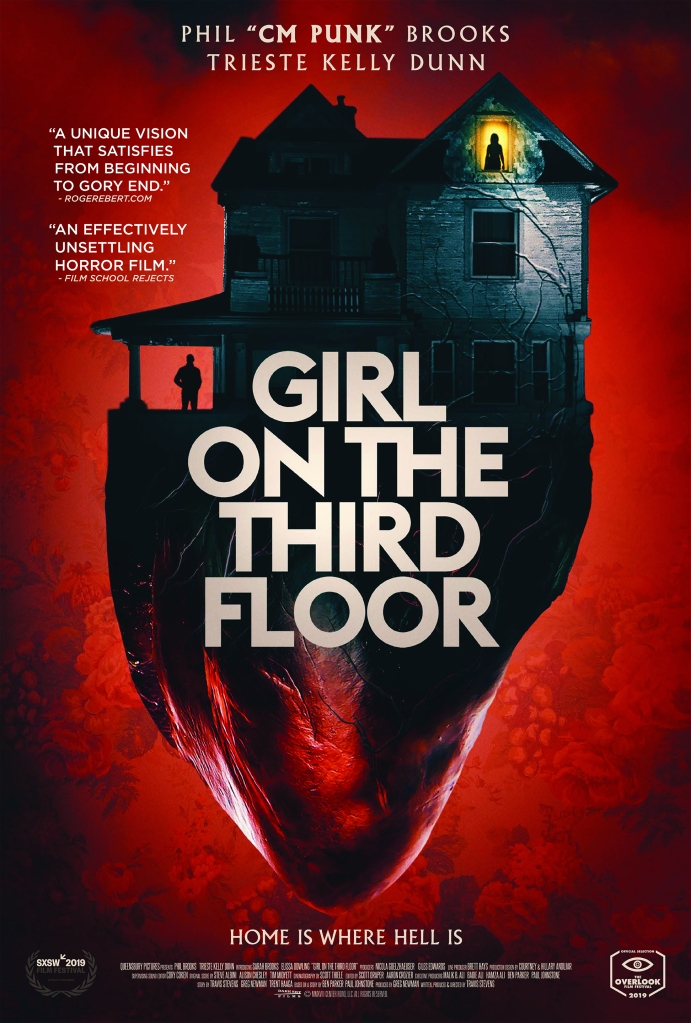 The film poster showing the house in front of a red background. The basement is shaped like the bottom half of a heart.