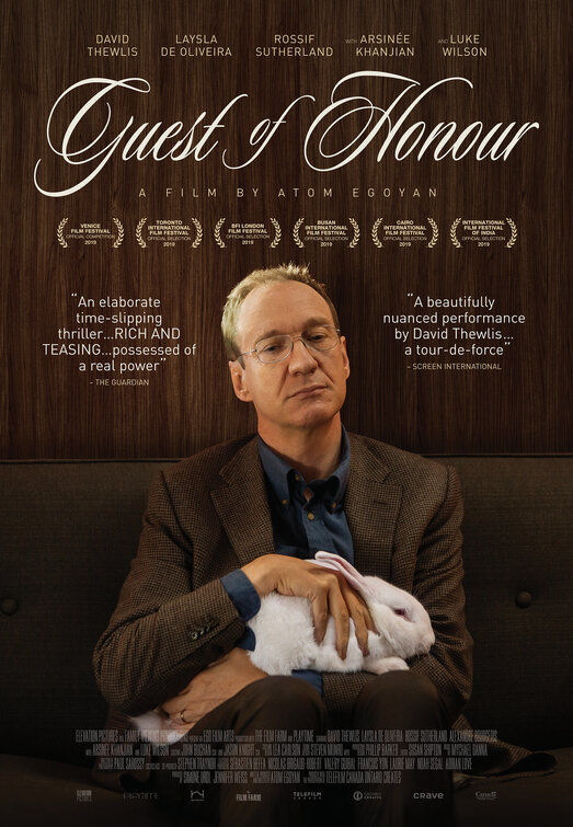 The film poster showing Jim (David Thewlis) stroking a white rabbit.