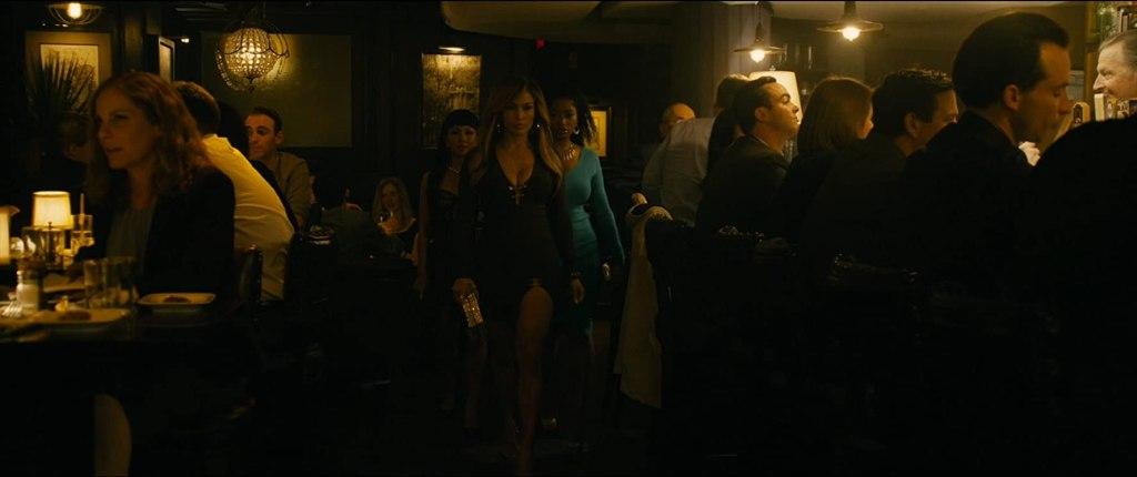Ramona (Jennifer Lopez) walking with Destiny (Constance Wu) and Mercedes (Keke Palmer) into a bar.