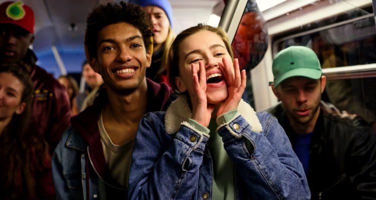 Katya (Alexandra Pfeifer) and Marlon (Yalany Marschner) watch their friends dance.