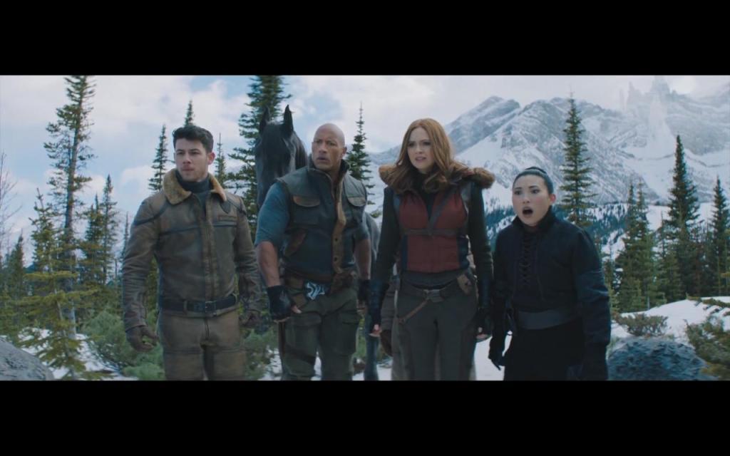Seaplane (Nick Jonas), Bravestone (Dwayne Johnson), Ruby (Karen Gillan) and Ming (Awkwafina) in a snowy landscape.
