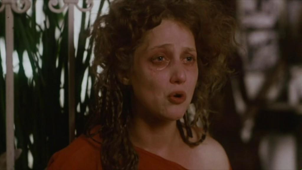 Cissy (Carol Kane) is distraught.