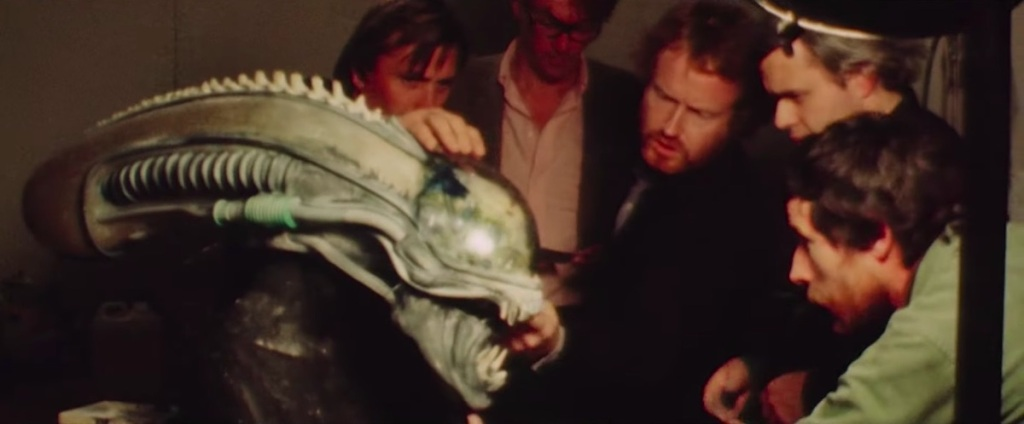 The filmmakers of Alien examining a model of the Alien head.