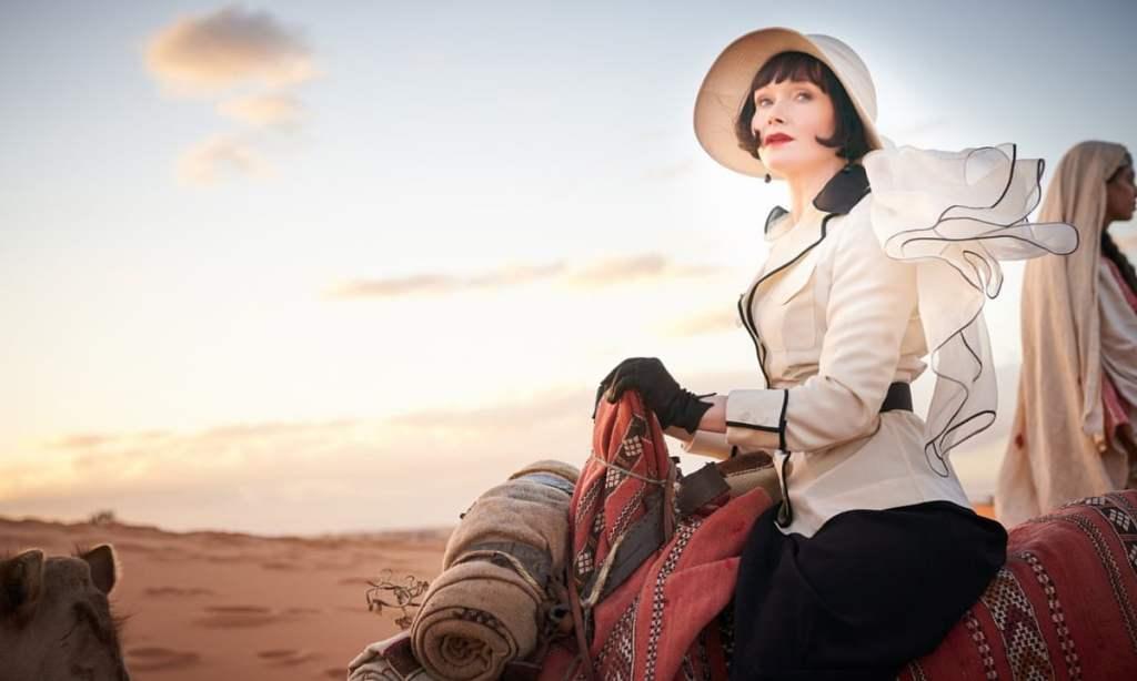 Phryne Fisher (Essie Davis) rides a camel.
