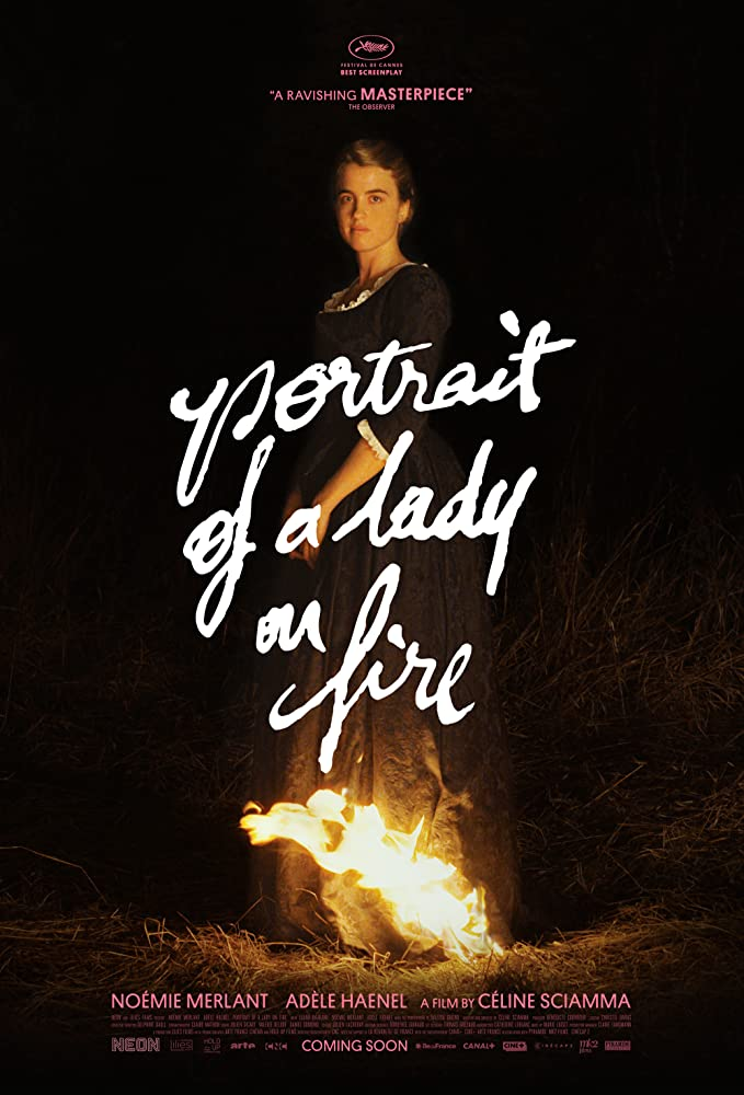 The film poster showing Héloïse (Adèle Haenel) standing in the dark, the bottom of her long dress on fire.